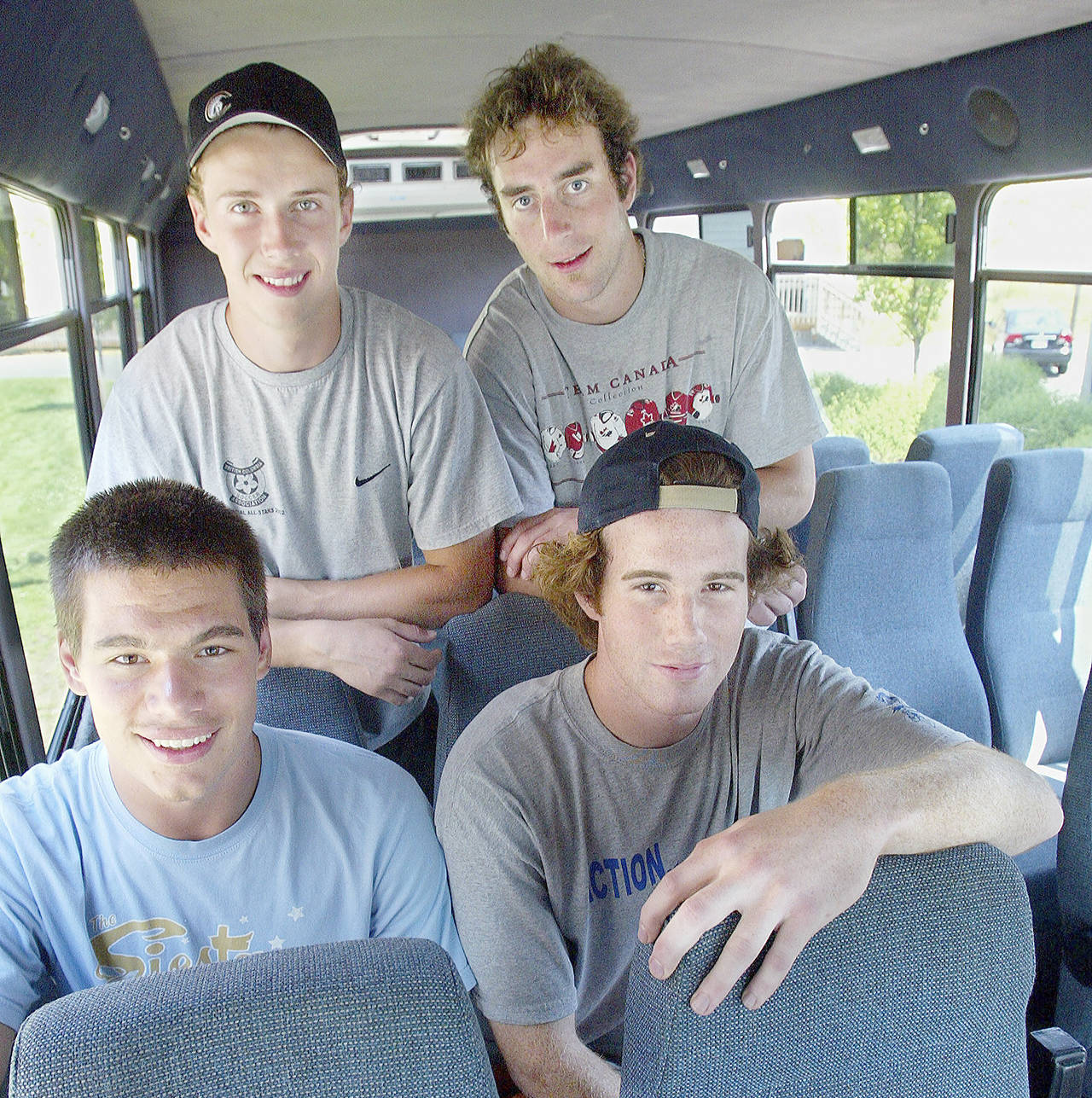 Mitch Love (top right) poses with teammates (clockwise from top left) Torrie Wheat, Jeff Harvey and Jovan Matic prior to the start of the Everett Silvertips' inaugural season in 2003. (Michael O'Leary / The Herald)