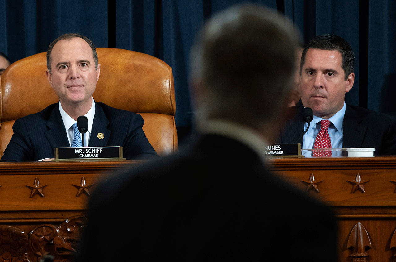 House Intelligence Committee Chairman Rep. Adam Schiff, D-California, (left) and ranking member Rep. Devin Nunes, R-California, watch as yop U.S. diplomat in Ukraine William Taylor leaves after testifying at a hearing of the House Intelligence Committee on Capitol Hill in Washington, Wednesday, during the first public impeachment hearing of President Trump's efforts to tie U.S. aid for Ukraine to investigations of his political opponents. (Saul Loeb / Pool Photo)