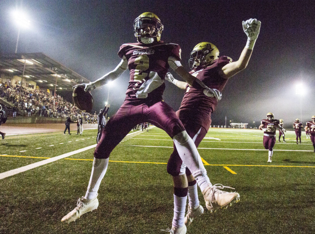 Lakewood's Carson Chrisman (left) celebrates after scoring a touchdown during a 2A state playoff game against Sequim on Friday in Arlington. (Olivia Vanni / The Herald)