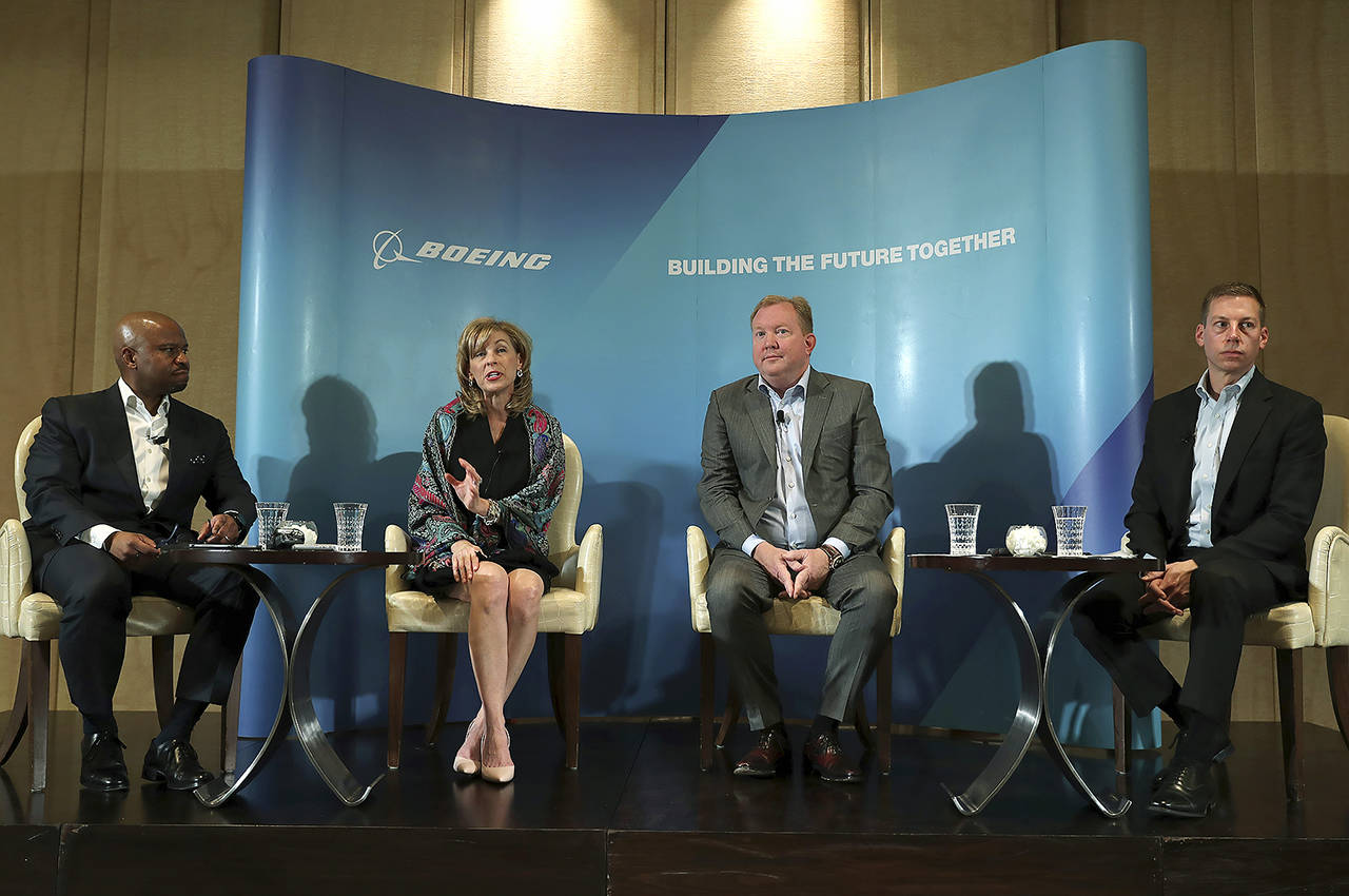 From left to right, Ted Colbert President and CEO of Boeing Global Services, Leanne Caret president and CEO of Boeing Defense, Space & Security, Stan Deal executive vice president of Boeing Company and president and chief executive officer of Boeing Commercial Airplanes and Gordon Johndroe vice president of Government Operations Communications of Boeing, attend the Boeing press conference a day ahead Dubai Airshow in Dubai, United Arab Emirates on Saturday. (AP Photo/Kamran Jebreili)
