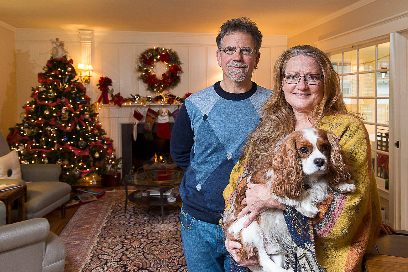 Bill and JJ Leese stand in the living room of their home on Friday, Nov. 15, 2019 in Everett, Wash. The well traveled couple's house will be part of the Holiday Home Tour in Everett. (Andy Bronson / The Herald)