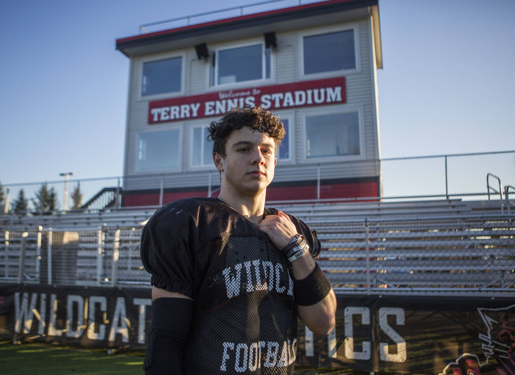 Archbishop Murphy's Joe Ennis, the grandson of legendary high school football coach Terry Ennis, poses at Terry Ennis Stadium, home of the Wildcats, on Thursday in Everett. (Olivia Vanni / The Herald)