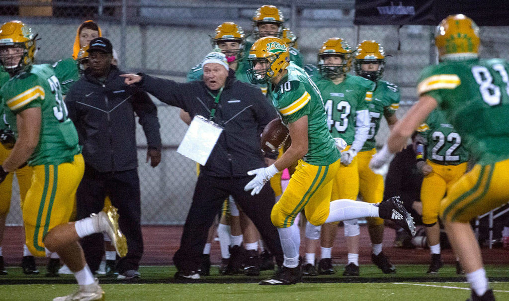 Tumwater defensive end Ryan Otton (center) returns an interception during a 2A state playoff game against Franklin Pierce on Nov. 15 at Tumwater District Stadium. (Tony Overman / The Olympian)