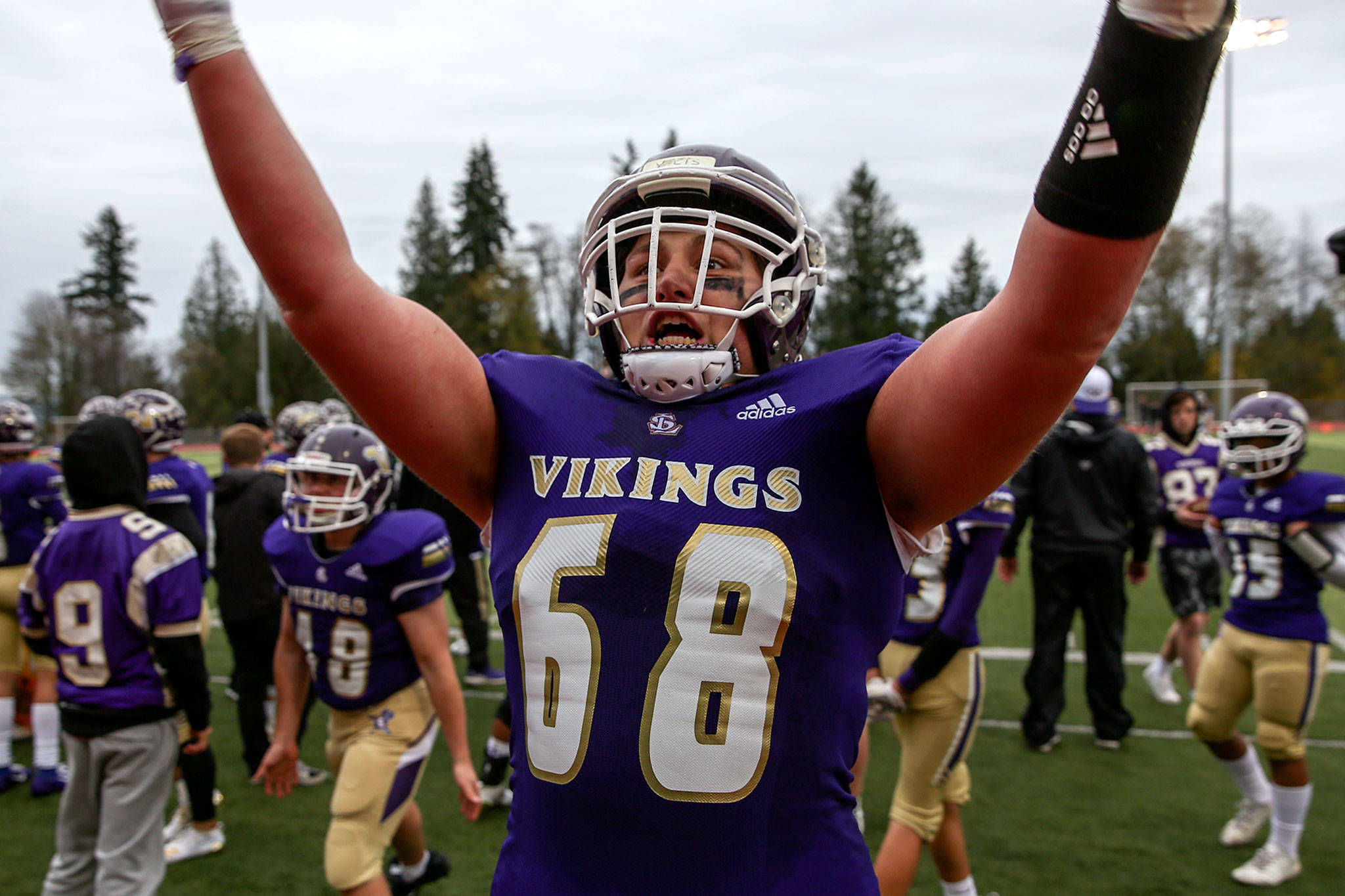 Lake Stevens standout left tackle Devin Kylany rallies the hometown crowd following the Vikings' first-round state-playoff win over Union last Saturday. It was the Washington State commit's first game back since recovering from a torn ACL. (Kevin Clark / The Herald)