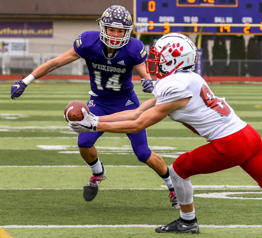 Mount Si's Stuart DeMerit intercepts a pass intended for Lake Stevens' Skyler Reyna Saturday afternoon at Lake Stevens High School on November 23, 2019. Lake Stevens lost to Mount Si, 24-22, ending their state championship run. (Kevin Clark / The Herald)