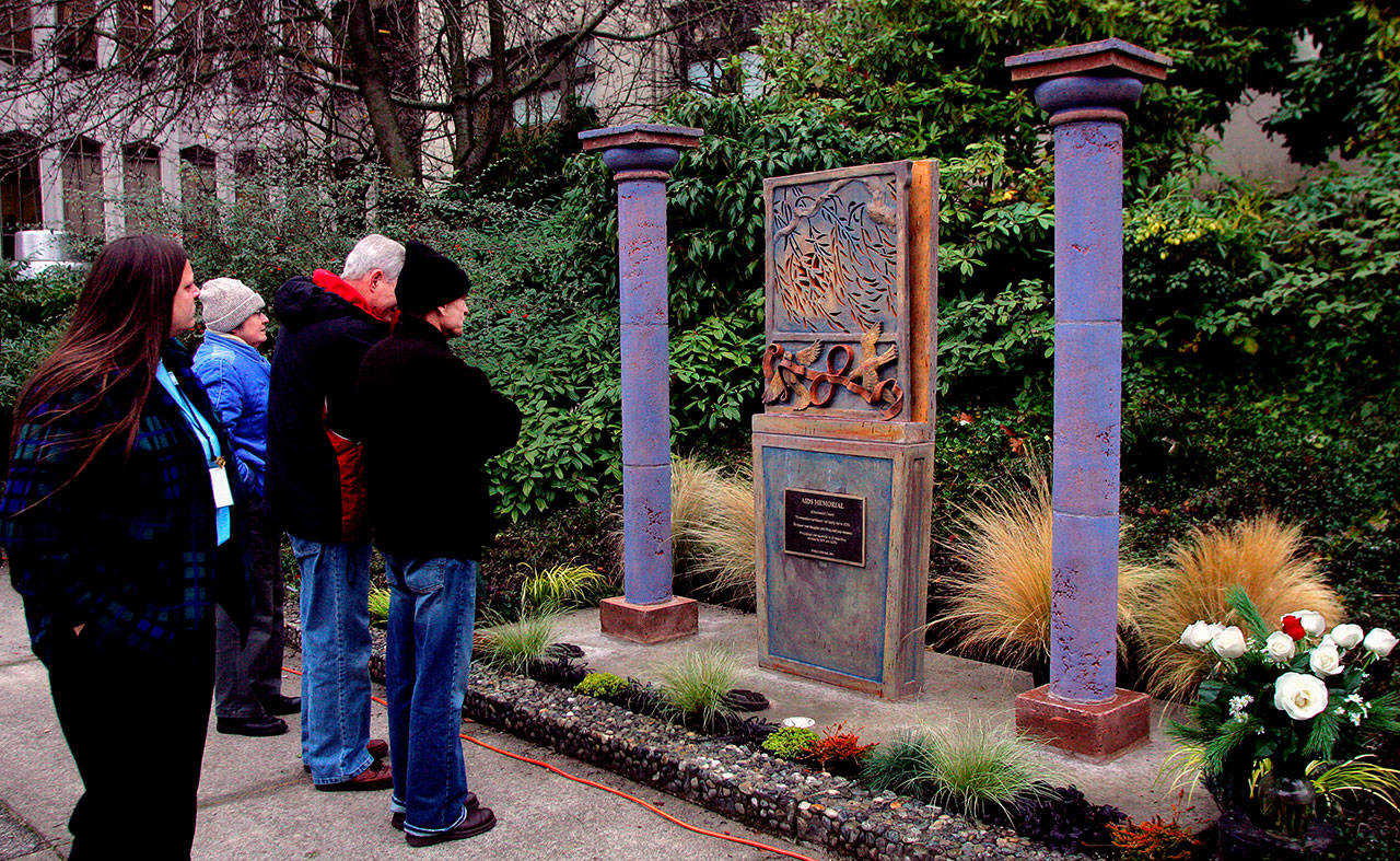 A crowd of about 50 people attended the dedication ceremony for the AIDS Memorial of Snohomish County in December 2005. A World AIDS Day event is scheduled for 2 p.m Sunday at the memorial, located west of the Mission Building on the Snohomish County Campus. (Michael O'Leary / Herald file)