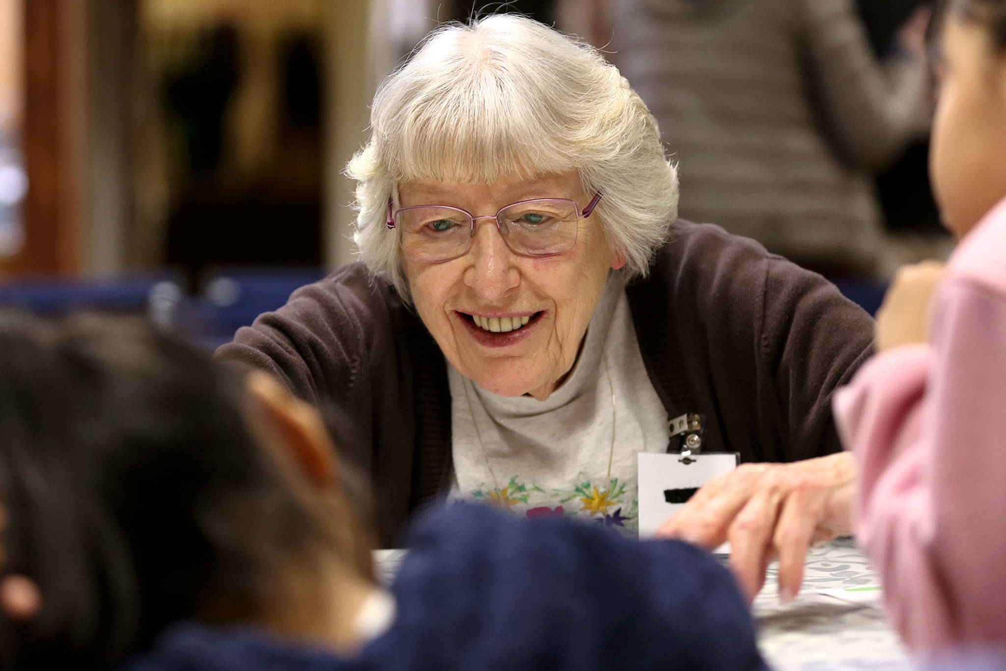 Margaret Ray helps students with worksheets in Monroe on Nov. 19. (Kevin Clark / The Herald)
