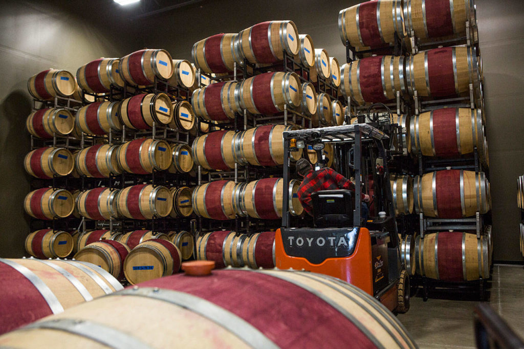 Barrels of wine are moved around at JM Cellars at The Vault in Maltby. (Olivia Vanni / The Herald)