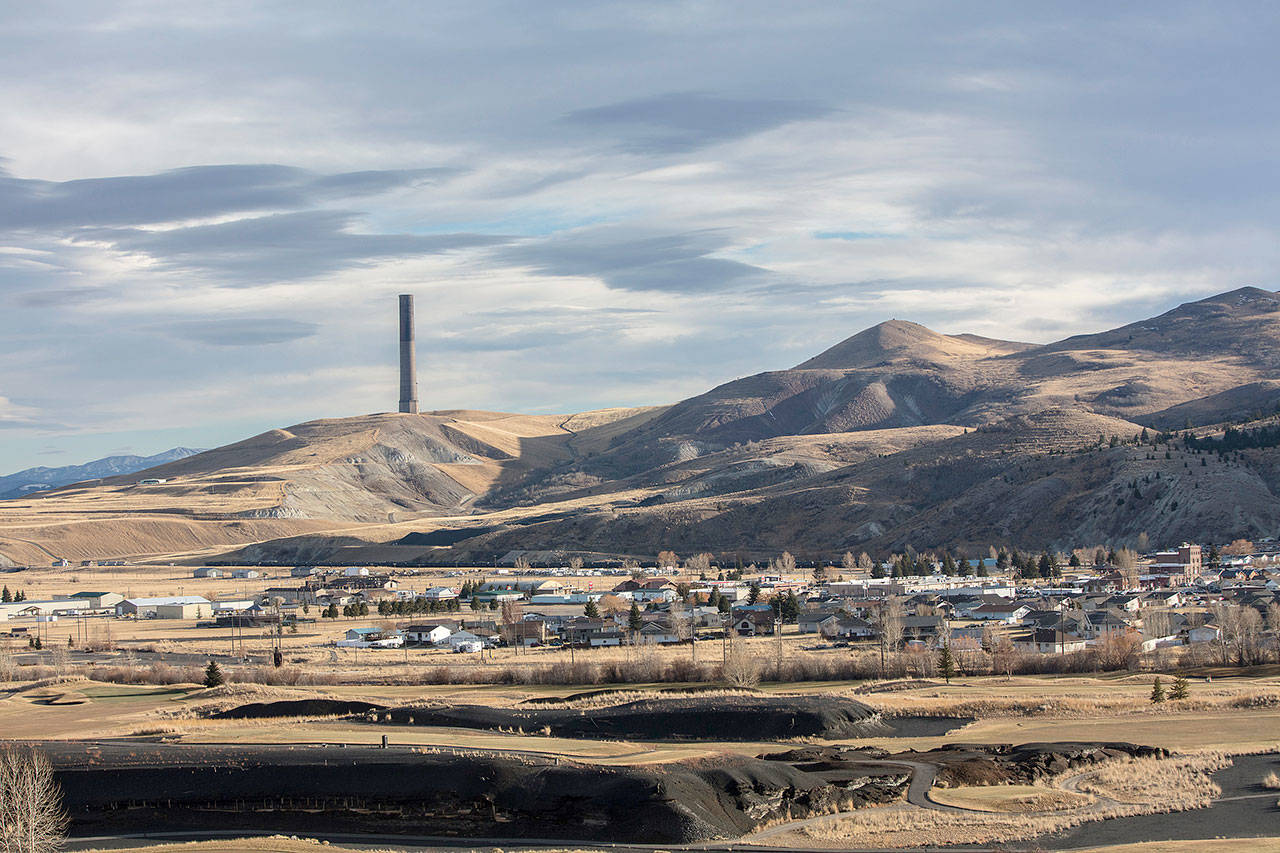 An abandoned smelter chimney, a legacy of what once was the world's largest copper mining operation, looms over the Anaconda valley in southwest Montana. (Louise Johns / For The Washington Post)