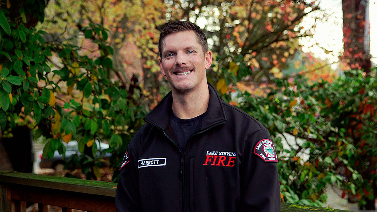 Water Rescue Award: Christopher Harrott, firefighter, saved woman from submerged car. (American Red Cross)