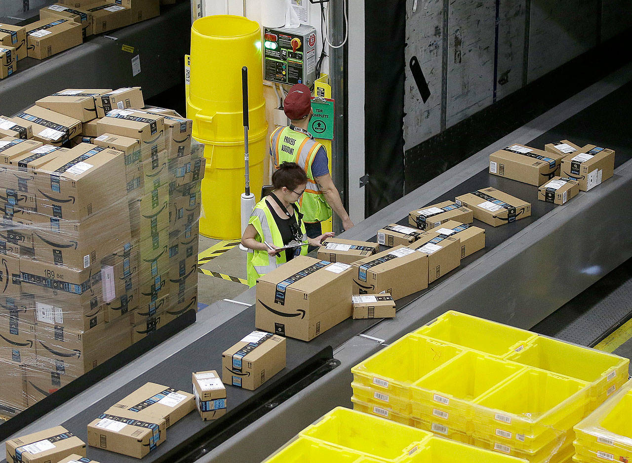 Packages move down a conveyor system were they are directed to the proper shipping area at the new Amazon Fulfillment Center in Sacramento, California, in 2018. Cyber Monday is still holding up as the biggest online shopping day of the year. (AP Photo/Rich Pedroncelli, File)