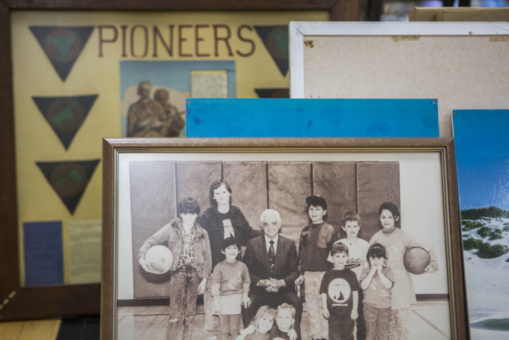 Old photos sit in a gym. (Olivia Vanni / The Herald)