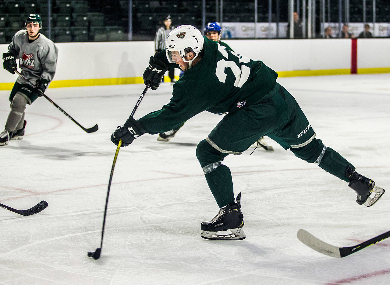 The Silvertips' Jake Christiansen (center) takes a shot and scores during the annual Green and Grey scrimmage Aug. 25, 2019, in Everett. (Olivia Vanni / The Herald)