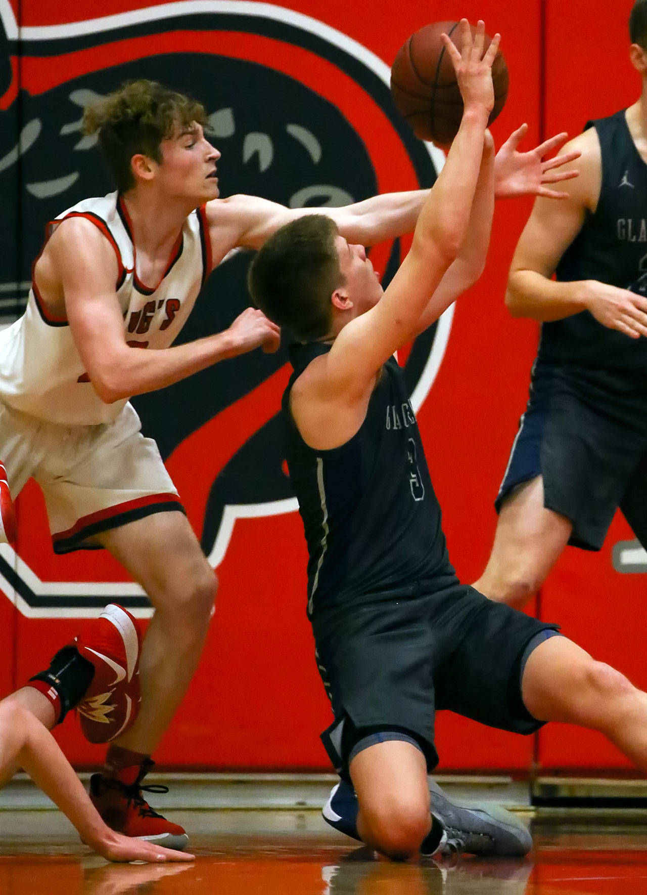 Glacier Peak's Bobby Siebers (right) makes a basket from the floor with King's Will Pohland defending Friday evening at King's School in Shoreline. The Grizzles won 58-53. (Kevin Clark / The Herald)