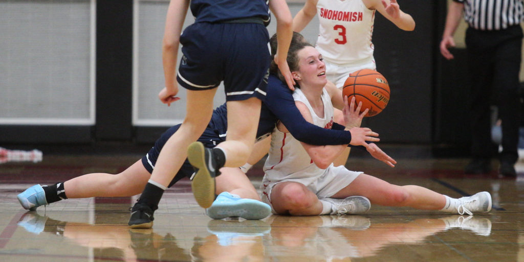 Snohomish's Gracie VanAssche throws a pass from the floor after grabbing the loose ball in the Panthers' 50-39 loss to rival Glacier Peak in a non-league girls basketball game on Monday, Dec. 9, 2019 in Snohomish, Wash. (Andy Bronson / The Herald)