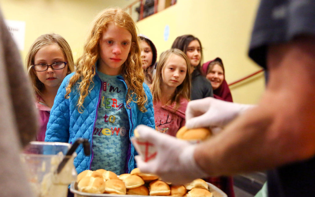 """This made my day,"" one student exclaimed as he stood in line for the hot meal. (Kevin Clark / The Herald)"