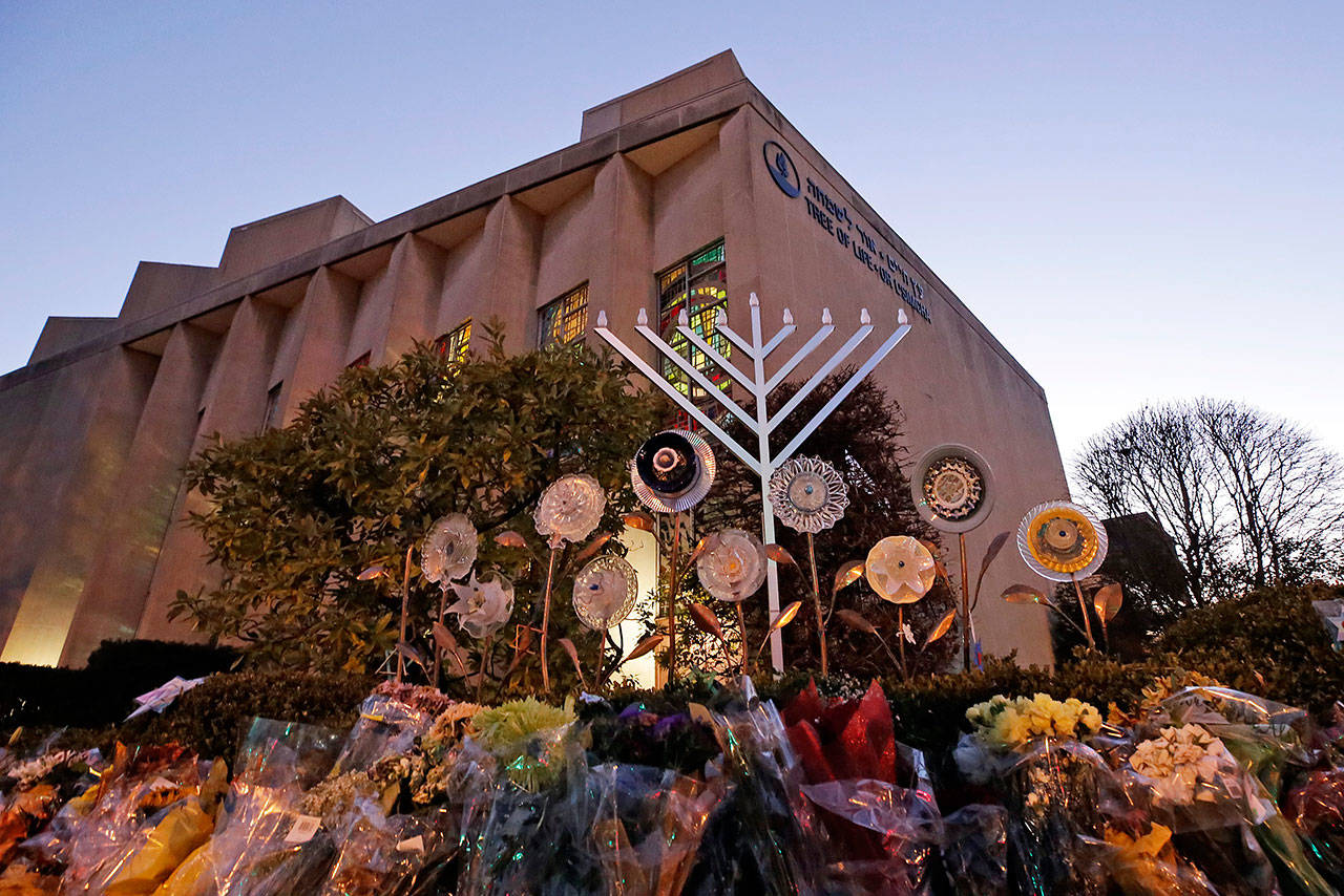 A menorah rises outside the Tree of Life Synagogue in preparation for a celebration service at sundown on the first night of Hanukkah in December 2018, in the Squirrel Hill neighborhood of Pittsburgh. A gunman shot and killed 11 people while they worshipped Saturday, Oct. 27, 2018 at the temple. (Gene J. Puskar / Associated Press file)