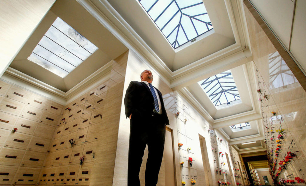 Pete Cameron, general manager of Evergreen Funeral Home and Cemetery, watches over View Crest Abbey Mausoleum, where some of his ancestors are entombed. (Dan Bates / The Herald)