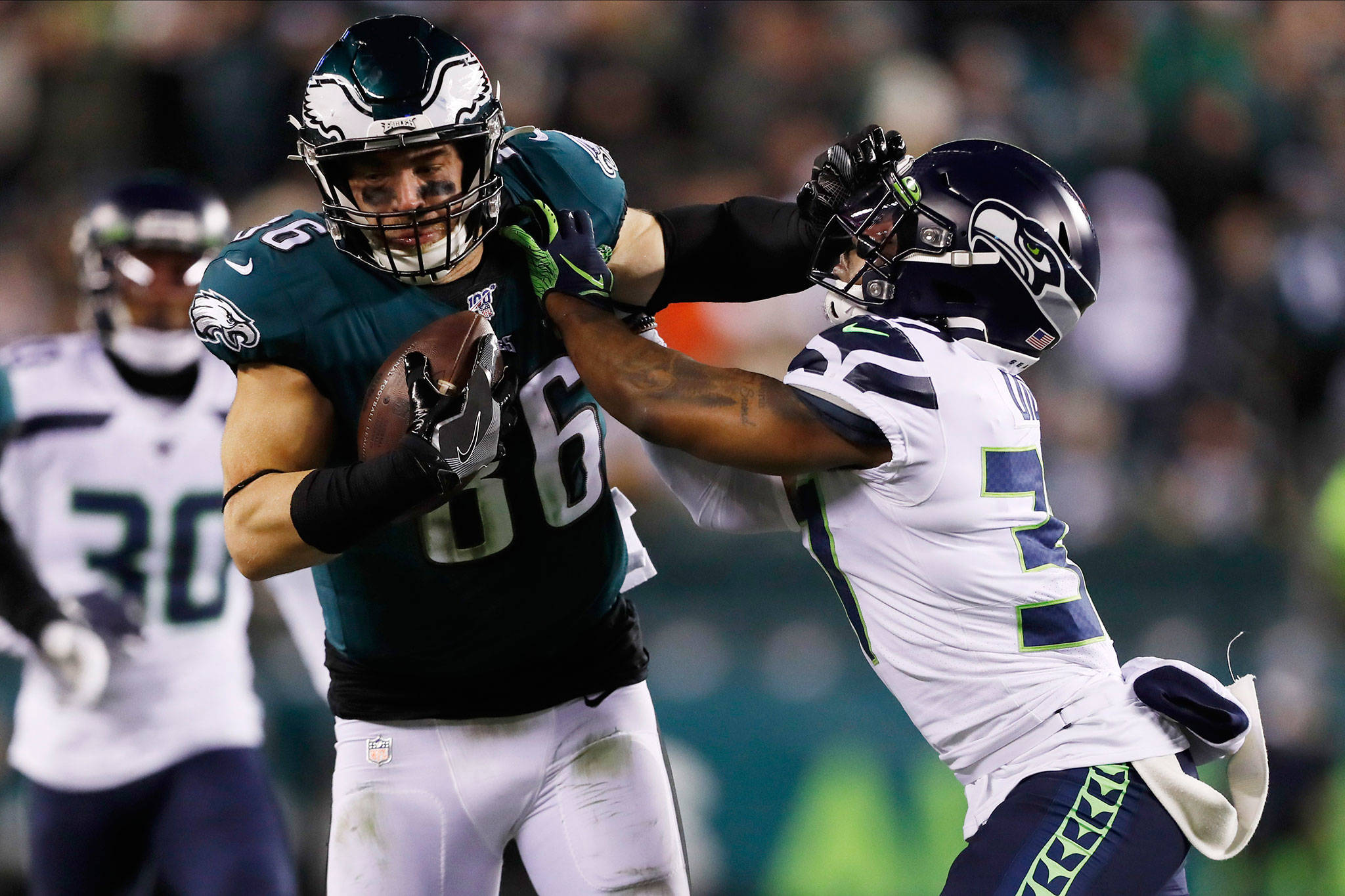 The Eagles' Zach Ertz (left) tries to hold off the Seahawks' Quandre Diggs during the second half of a wild-card playoff game this past Sunday in Philadelphia. (AP Photo/Julio Cortez)