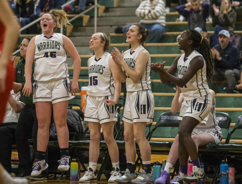 The Edmonds-Woodway bench reacts to a made 3-pointer during the Warriors' 44-33 Wesco 3A/2A win over Snohomish on Friday in Edmonds. (Olivia Vanni / The Herald).