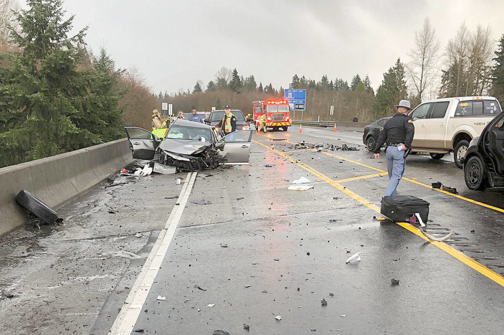 First responders inspect the wreckage of a three-car crash Sunday afternoon on U.S. 2 near Highway 9 and Bickford Avenue in Snohomish. (Washington State Patrol)
