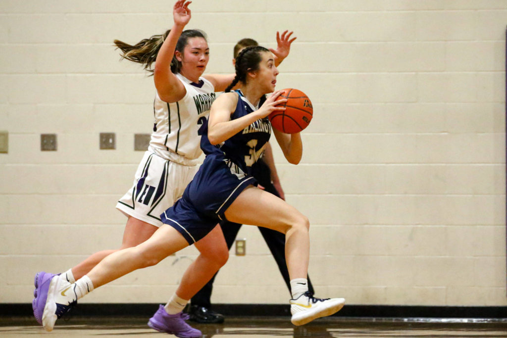 Arlington defeated Edmonds-Woodway 60-34 Thursday evening at Edmonds-Woodway High School on January 16, 2020. (Kevin Clark / The Herald)