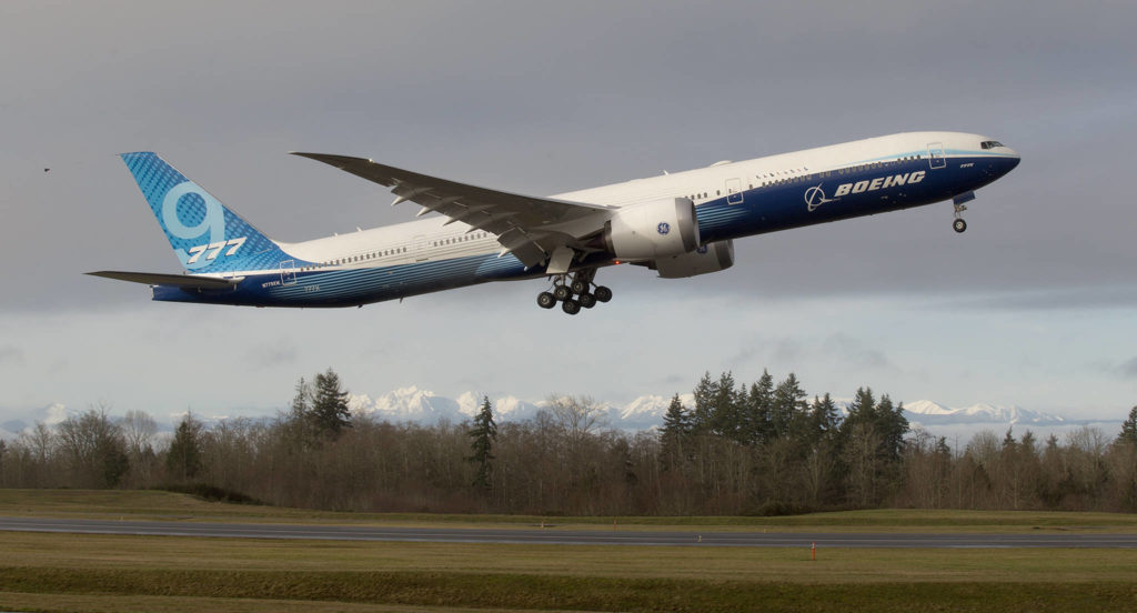 With the Olympic mountains in the background, Boeing's 777X lifts off from Paine Field on its first flight Saturday in Everett. (Andy Bronson / The Herald)