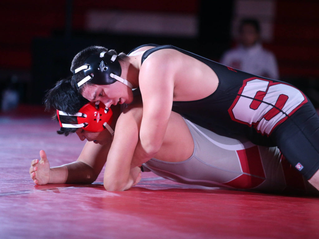 Snohomish's Karson Castillo, top, keeps Anthony Fitzgibbon on the mat as Snohomish lost to Stanwood 41-39 in a boys' wrestling meet on Tuesday, Jan. 28, 2020 in Snohomish, Wash. (Andy Bronson / The Herald)