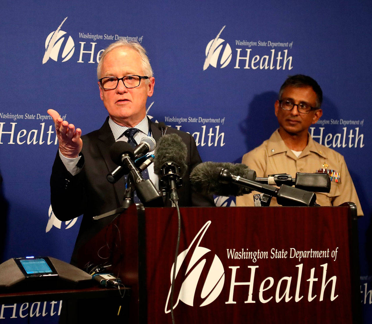 Dr. Jay Cook, with Providence Regional Medical Center Everett, speaks at a news conference at Washington state's Department of Health Public Health Laboratories, Tuesday, in Shoreline, while speaking on the condition of a patient who is in good condition with the coronavirus. At right is Dr. Satish Pillai, of the Centers for Disease Control and Prevention, in Atlanta. (Greg Gilbert / The Seattle Times)
