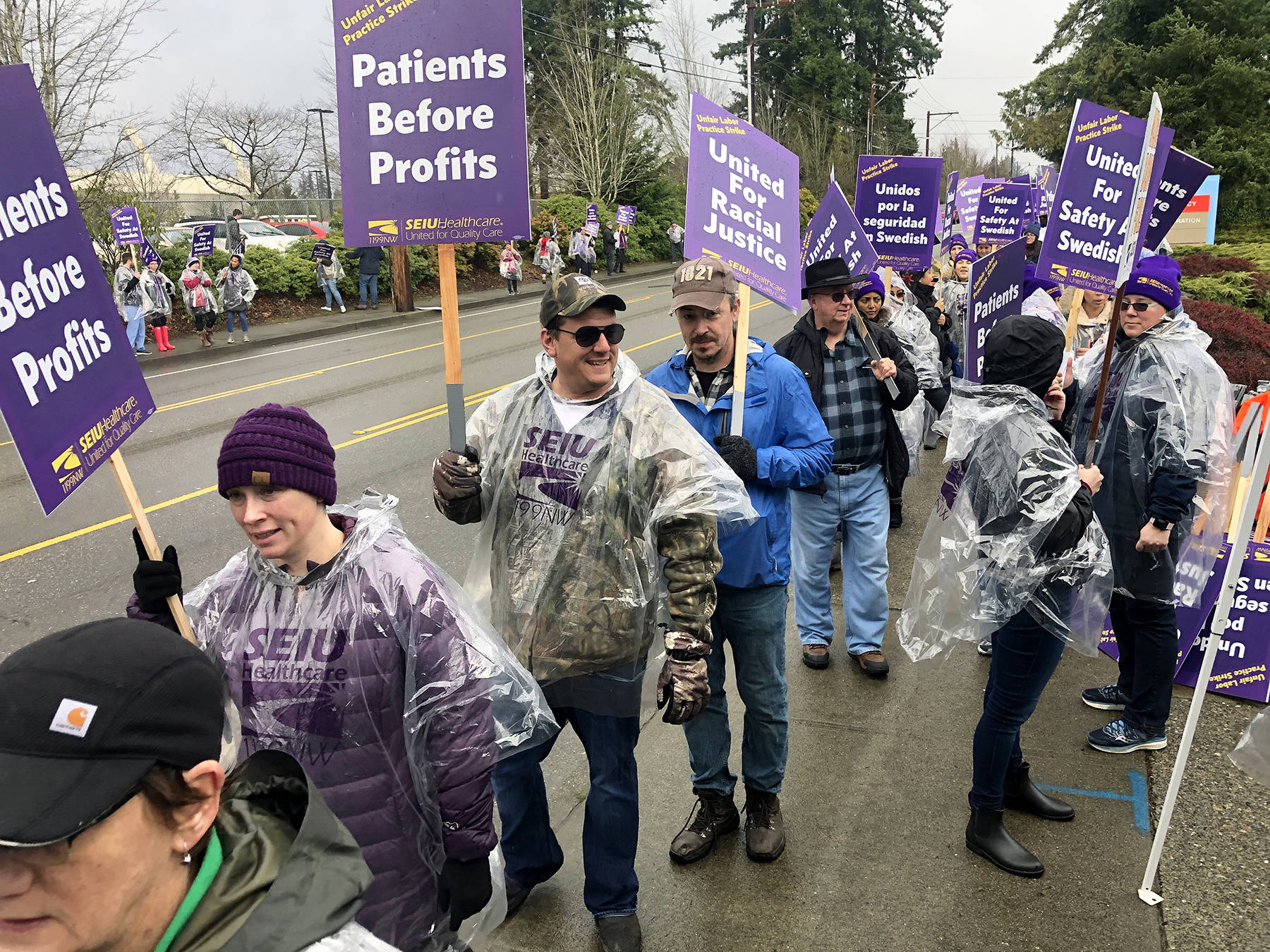 Striking nurses and caregivers at Swedish Edmonds form the picket line outside the hospital on Tuesday. (Andy Bronson / The Herald)