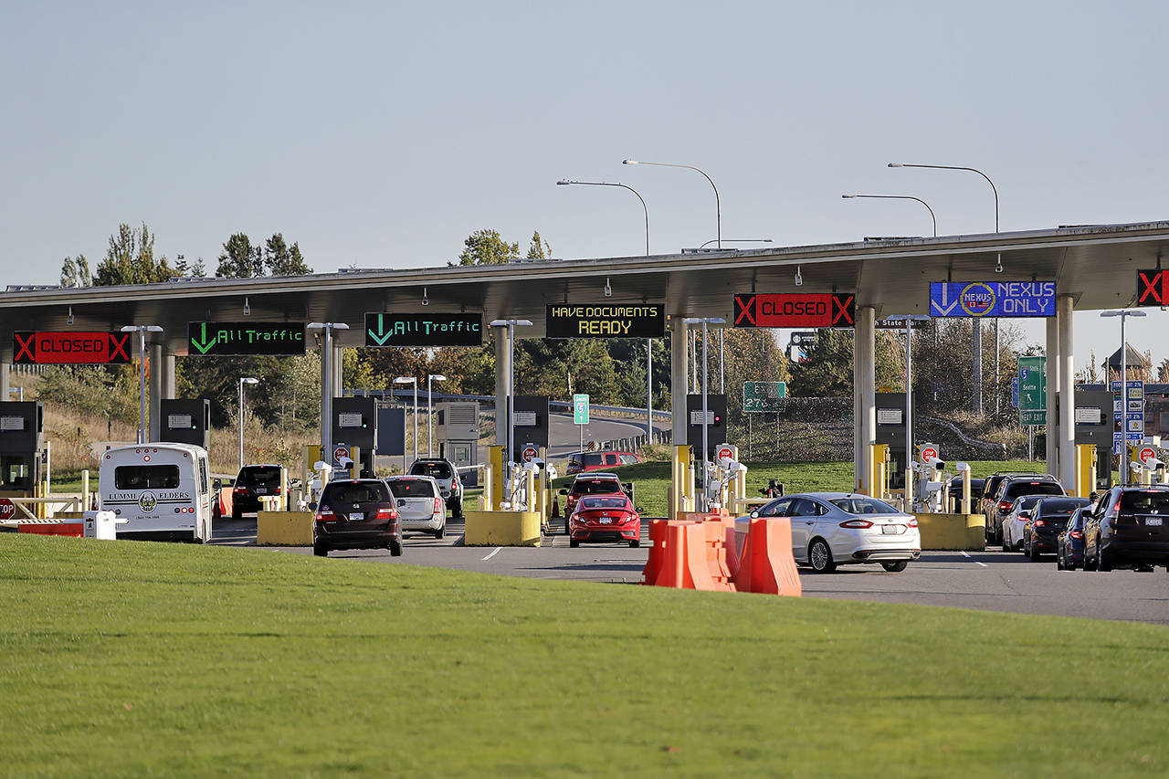 In this Oct. 9, 2019 photo, traffic enters the United States from Canada at the Peace Arch Border Crossing, in Blaine. (AP Photo/Elaine Thompson, file)
