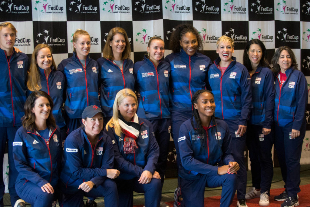 Unite States team members and support staff pose for a group photo Thursday after the official draw ceremony for the Fed Cup event taking place this weekend at Angel of the Winds Arena in Everett. (Andy Bronson / The Herald)