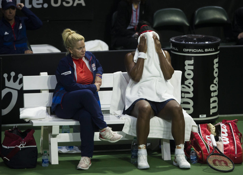 Serena Williams puts a towel over her face during a break in her match at the Fed Cup at Angel of the Winds Arena on Friday in Everett. (Olivia Vanni / The Herald)