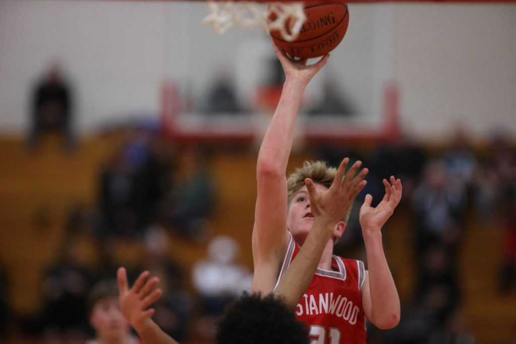 Stanwood's Dom Angelshaug takes a shot as Marysville Pilchuck beat Stanwood 76-31 in a basketball game Monday, Feb. 10, 2020 in Marysville. (Andy Bronson / The Herald)