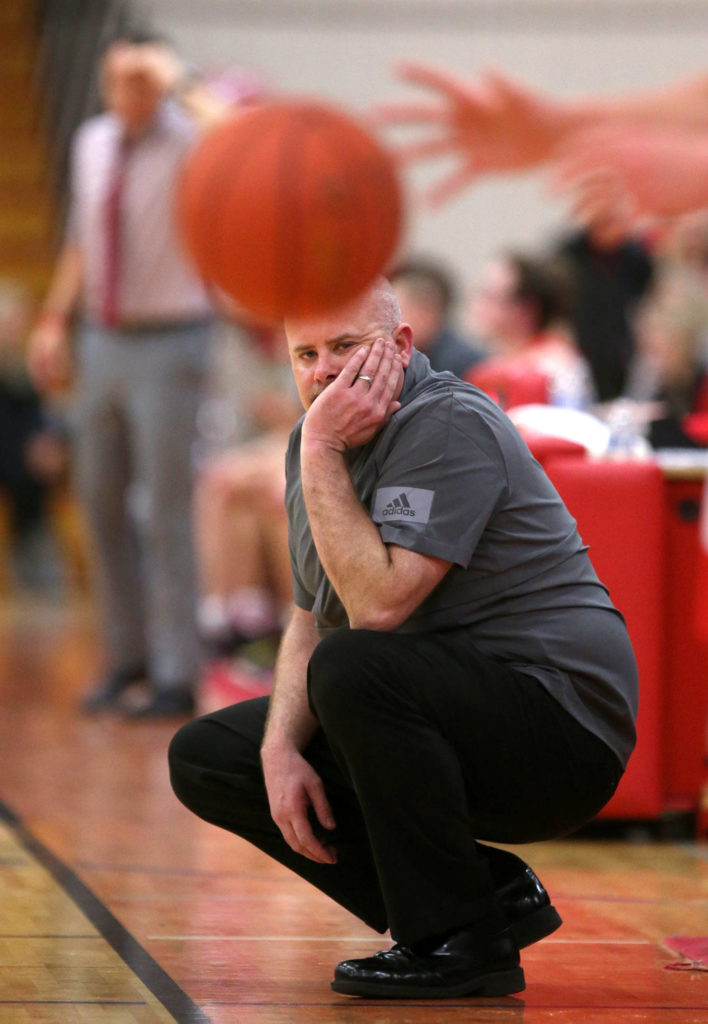 Stanwood head coach Zach Ward watches as a player inbounds the ball. Marysville Pilchuck beat Stanwood 76-31 in a basketball game Monday, Feb. 10, 2020 in Marysville. (Andy Bronson / The Herald)