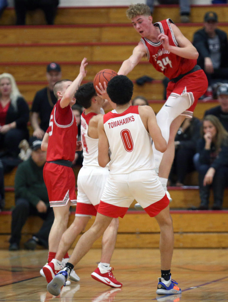 Stanwood's Kaeden McGlothin leaps to attempt a block as Marysville Pilchuck beat Stanwood 76-31 in a basketball game on Monday, Feb. 10, 2020 in Marysville. (Andy Bronson / The Herald)