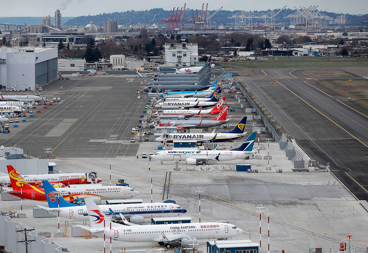 This 2018 photo shows airplanes parked at a Boeing facility at Boeing Field in Seattle. (AP Photo/Ted S. Warren, File)