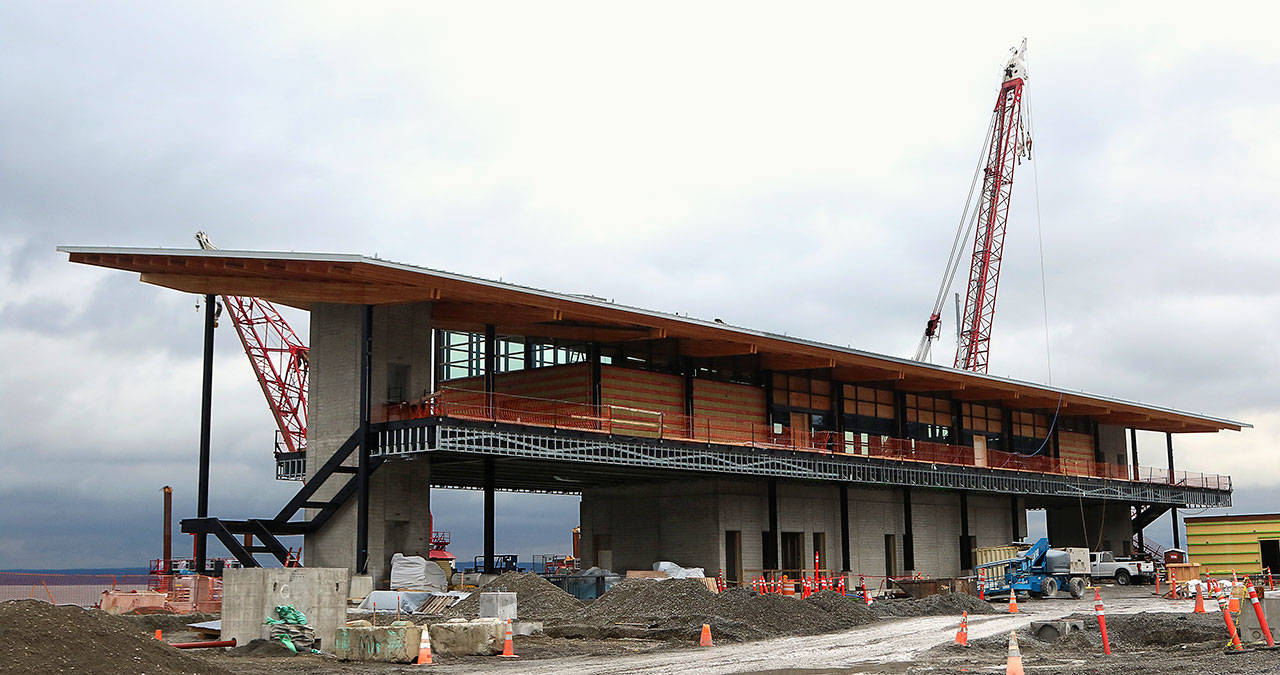 The new Mukilteo passenger ferry terminal, designed to resemble a Native American longhouse, takes shape Thursday. (Dan Bates / The Herald)