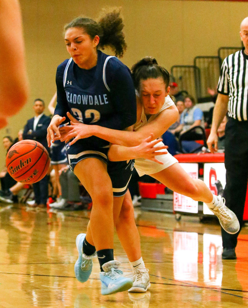 The Snohomish Panthers defeated the Meadowdale Mavericks, 57-39, in a 3A Northwest District Tournament game Friday night at Snohomish High School. (Kevin Clark / The Herald)