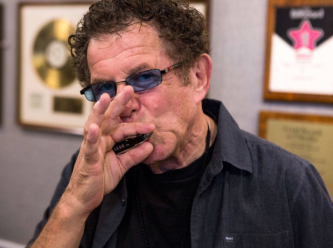 Lee Oskar plays his harmonica at his Everett home in September. The musician, best known for playing in the 1970s funk-rock fusion band War, will perform at a benefit concert for the Historic Everett Theatre on March 6. (Olivia Vanni / Herald file)