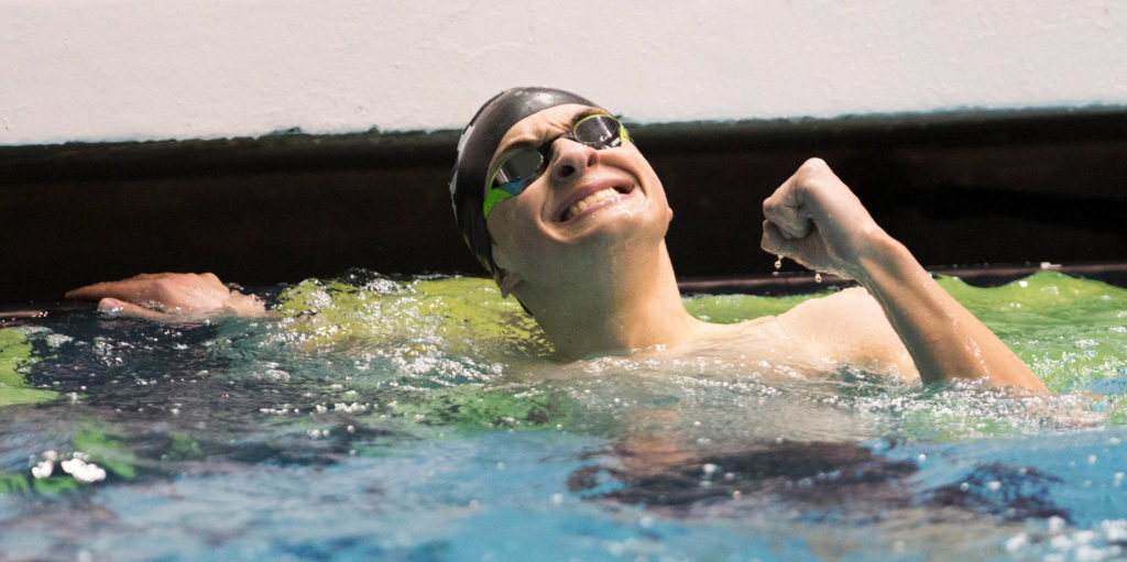 Lake Stevens' Alejando Flores reacts after coming in third in the 100 butterfly at the 4A state swim and dive championships on Saturday at the Federal Way Aquatic Center. (Andy Bronson / The Herald)