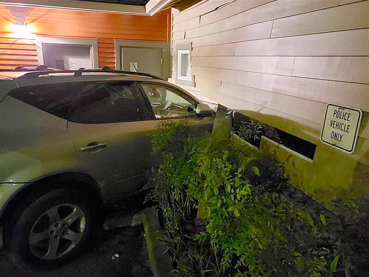 A woman in her 30s allegedly crashed her Nissan Murano into an Everett Fire Department station on Madison Street on Saturday night. (Everett Fire Department)