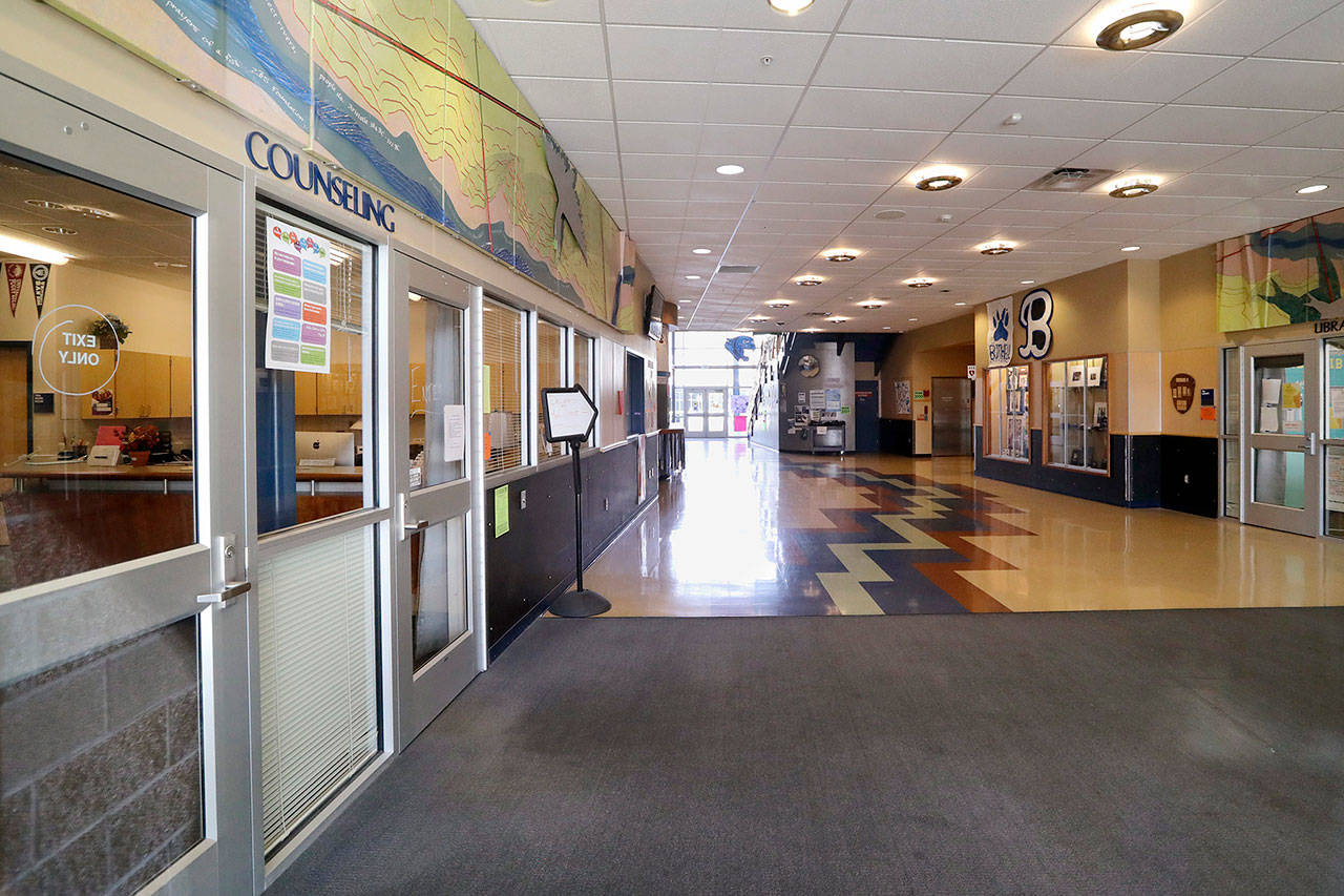 The halls inside Bothell High School, closed for the day, stand empty Thursday. (AP Photo/Elaine Thompson)