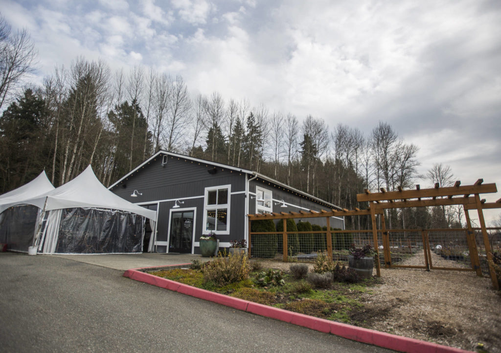 Outside of Matthews Winery which features outdoor seating and an organic vegetable garden on Friday in Woodinville. (Olivia Vanni / The Herald)