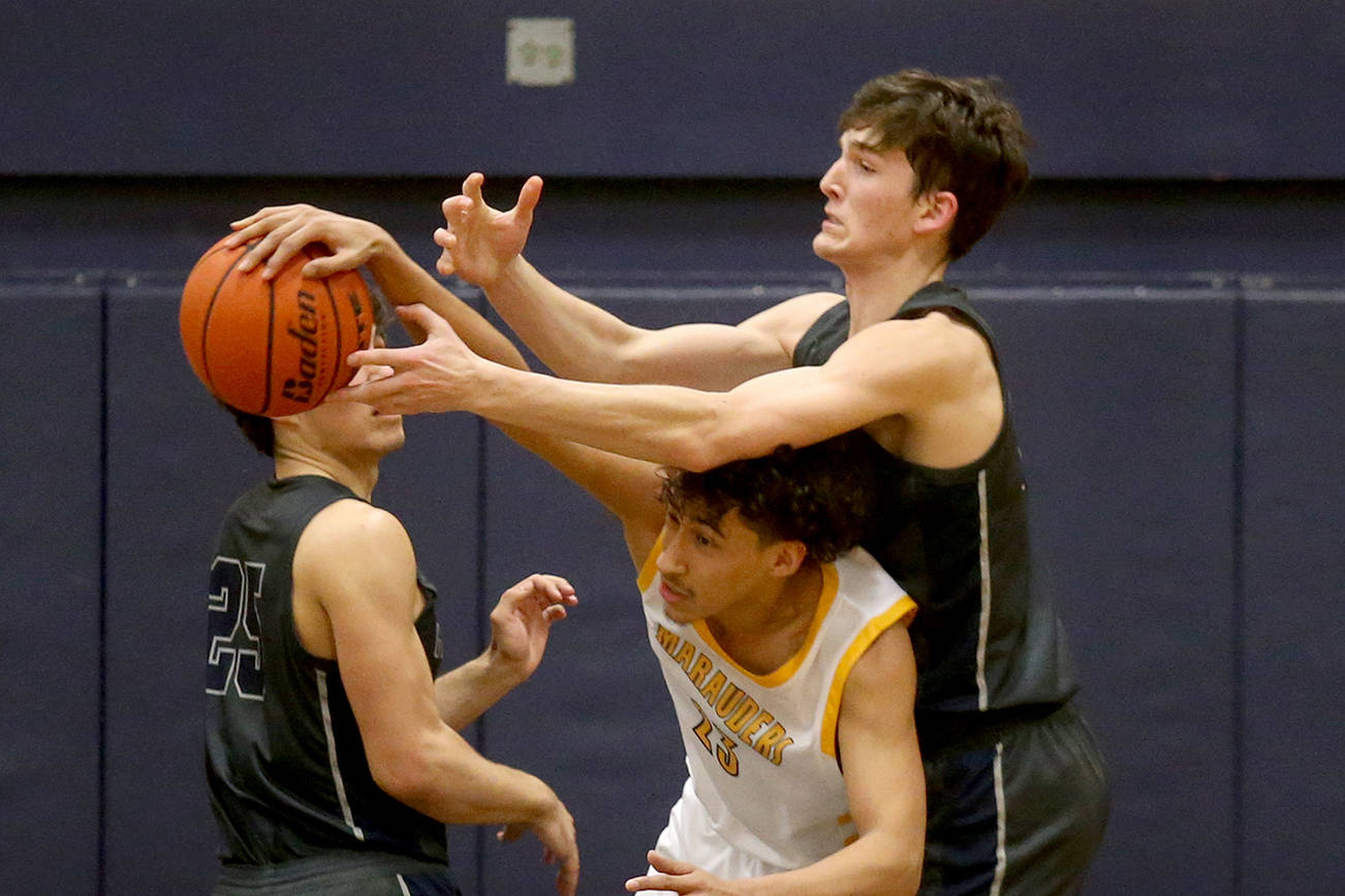 Pierce Darlington (right) and the Glacier Peak boys basketball team is one of 10 local squads headed to the Hardwood Classic beginning Wednesday. (Andy Bronson / The Herald)