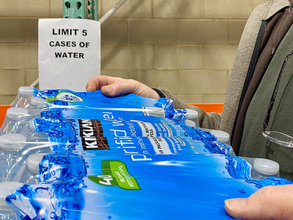 A store limited buyers to five cases of water on Friday. (Andrea Brown/The Herald)