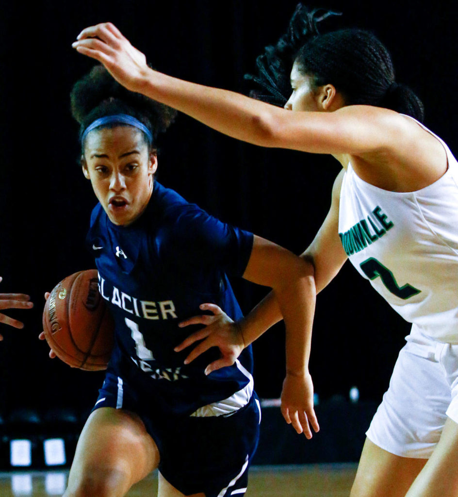 Glacier Peak's Aaliyah Collins drives the lane with Woodinville's Veronica Sheffey defending during the semifinals Friday afternoon at the Tacoma Dome on March 6, 2020. Glacier Peak lost 63-41. (Kevin Clark / The Herald)