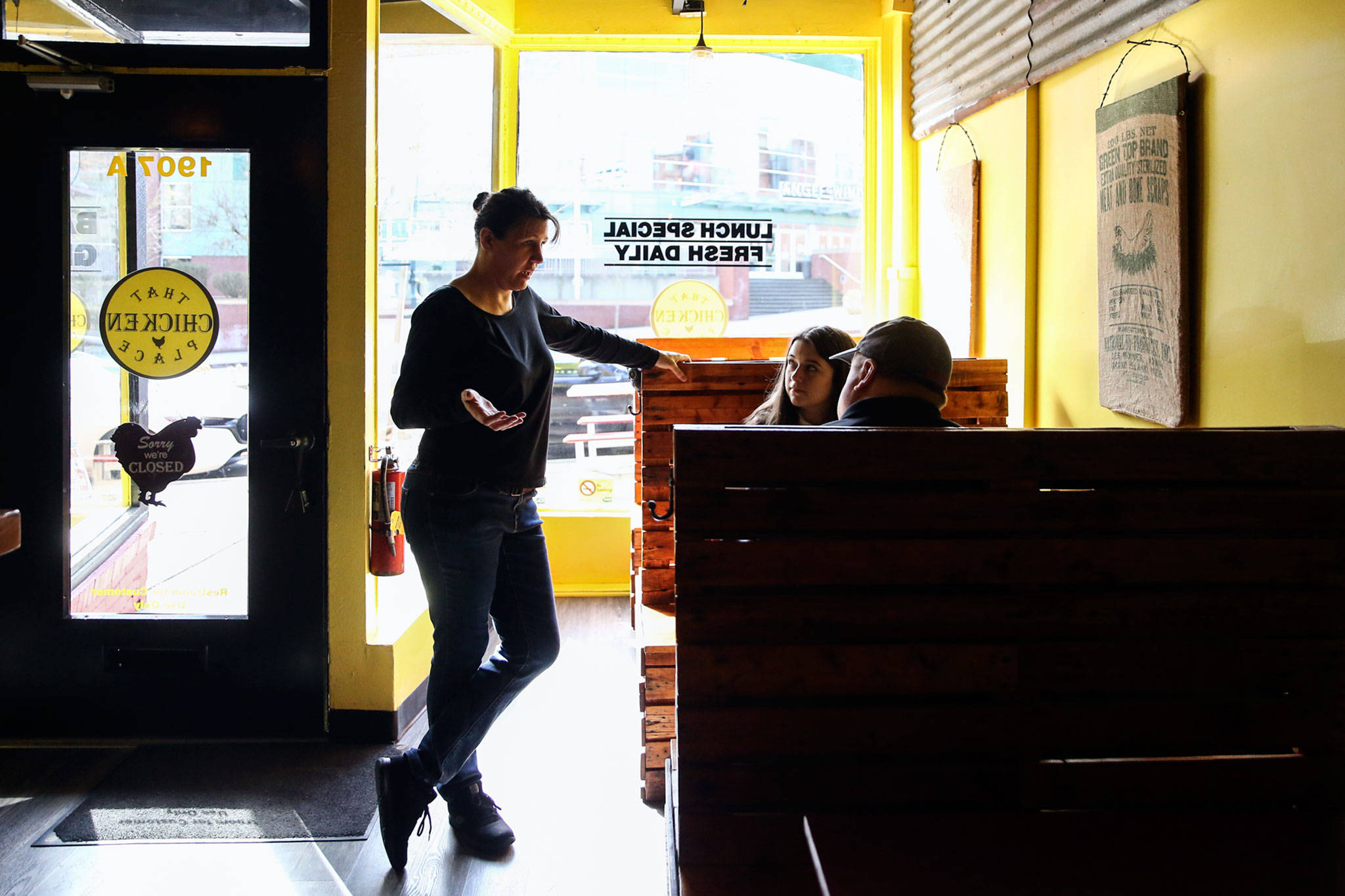 Brandy Wahlstrom, owner-operator of That Chicken Place on Hewitt Avenue in Everett, takes an order Saturday. All restaurants and bars in the state were ordered to close Tuesday. (Kevin Clark / The Herald)