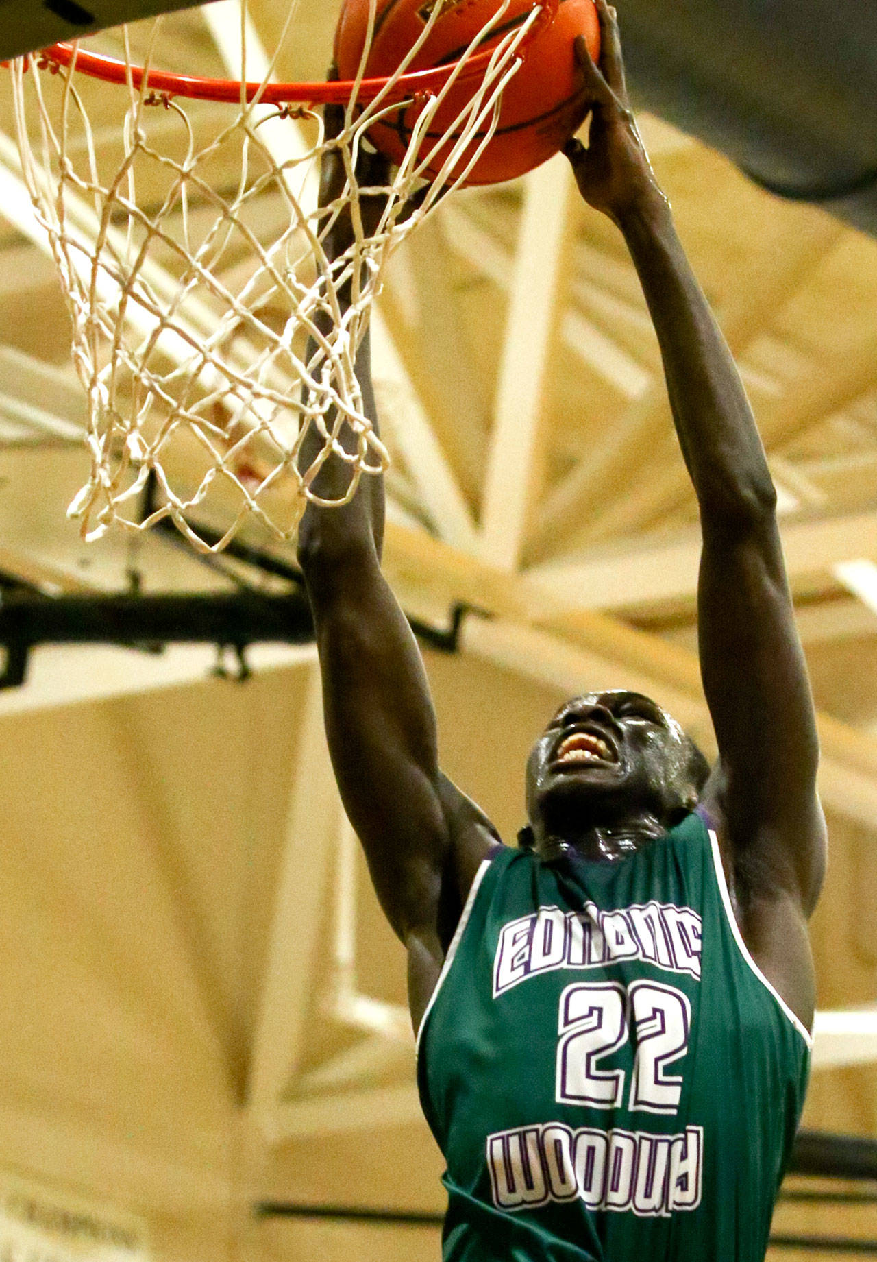 Edmonds-Woodway senior Mutdung Bol goes for a dunk. (Kevin Clark / The Herald)