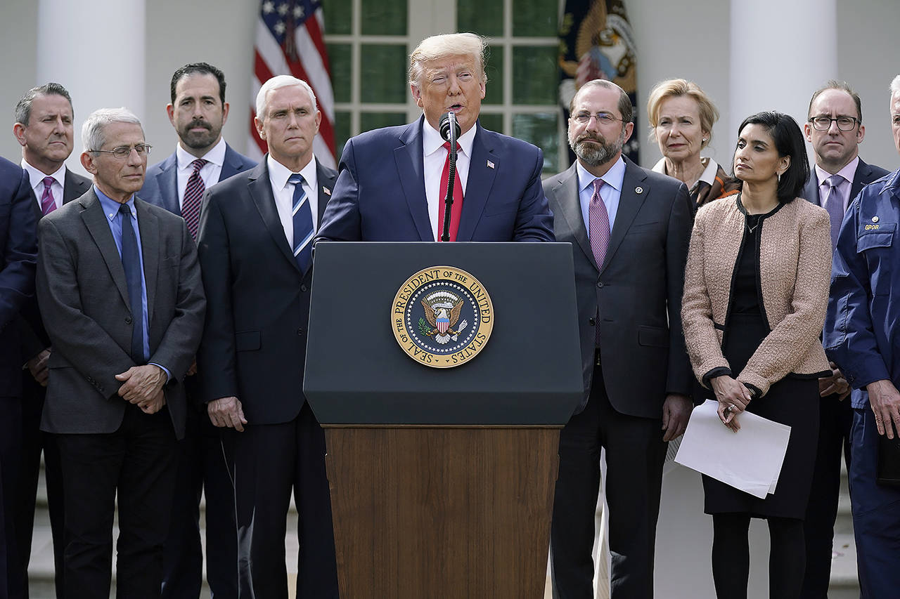 President Donald Trump speaks during a news conference about the coronavirus in the Rose Garden of the White House on Friday in Washington. (AP Photo/Evan Vucci)